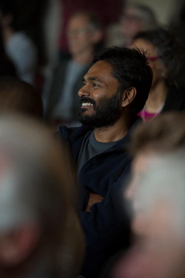 Man smiling at meeting on Sacramento Dharma Center
