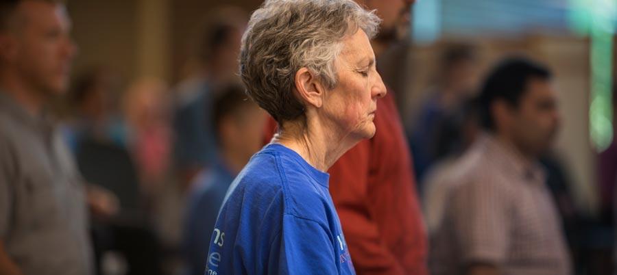 Woman meditating on Sacramento Dharma Center